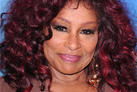 Chaka-khan-vibrant-red-hair-for-dark-skin-side